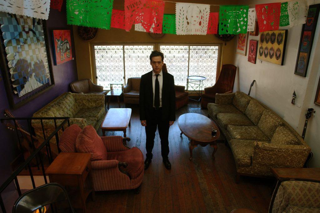 Chris Min as traveling Man at Zona Rosa