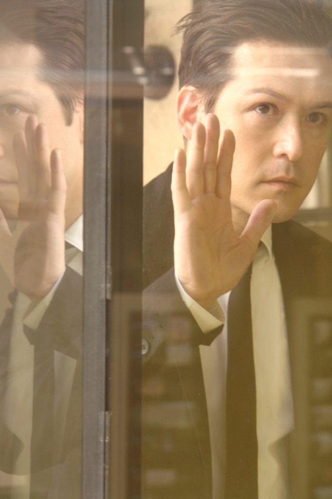 Chris looking through window