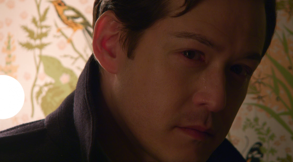 Traveling Man, played by Chris Min, moved to tears by the story of Compline