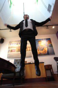 Chris flying toward the skylight