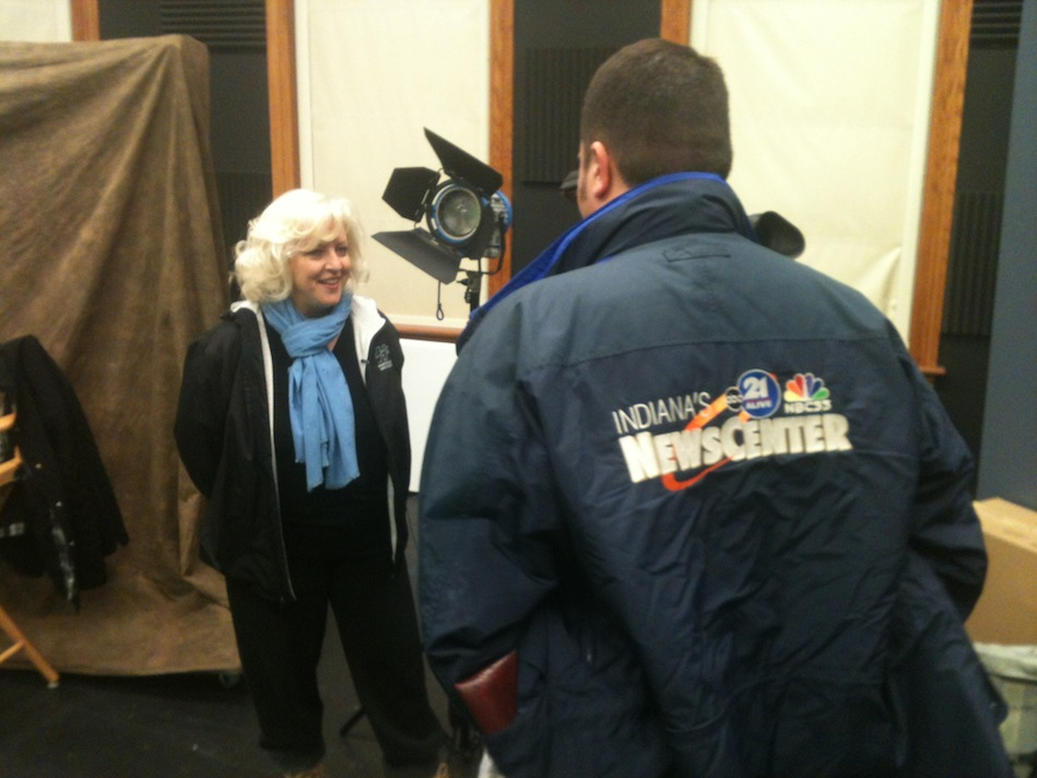 Director Lauralee Farrer interviewed by Indiana news while filming Compline
