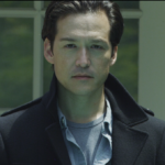 Christopher Min as Traveling Man